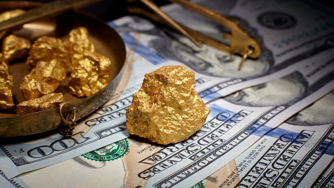Le record historique de l'or est un signe de remise en question sur le dollar américain